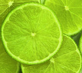 Lime slices abstract food background — Stock Photo