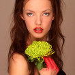Sultry woman with flower — Stok fotoğraf