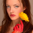 Woman with yellow flower. - Stock Photo