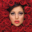 Girl In Red roses - Stock Photo