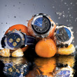 Foto Stock: Orange Watches