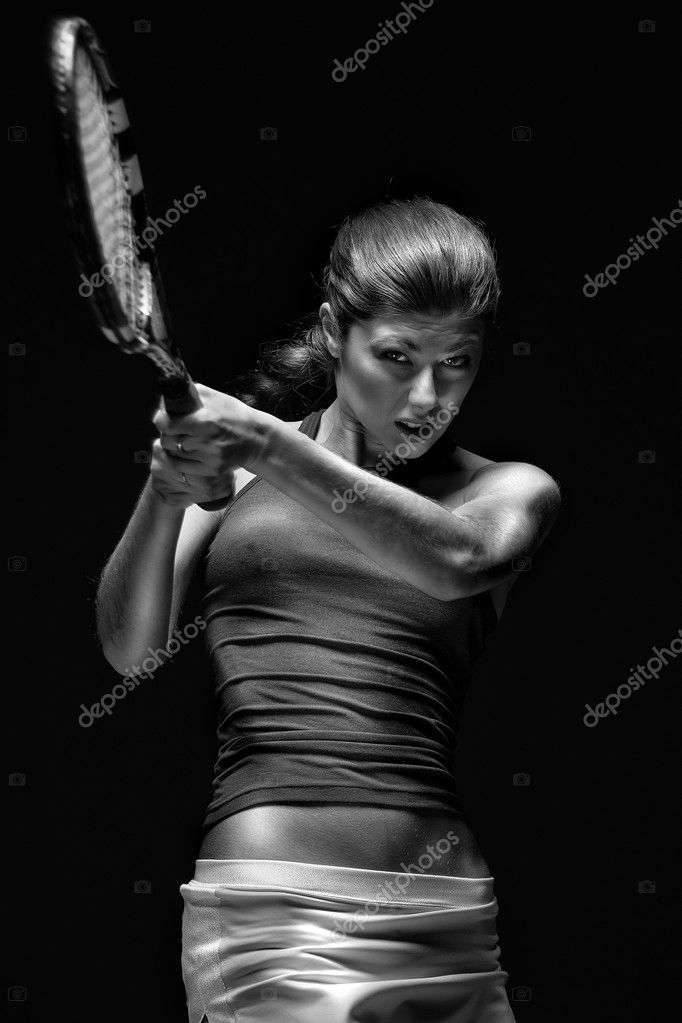 Female tennis player holding racket behind head, isolated on black background — Stock Photo #3042442