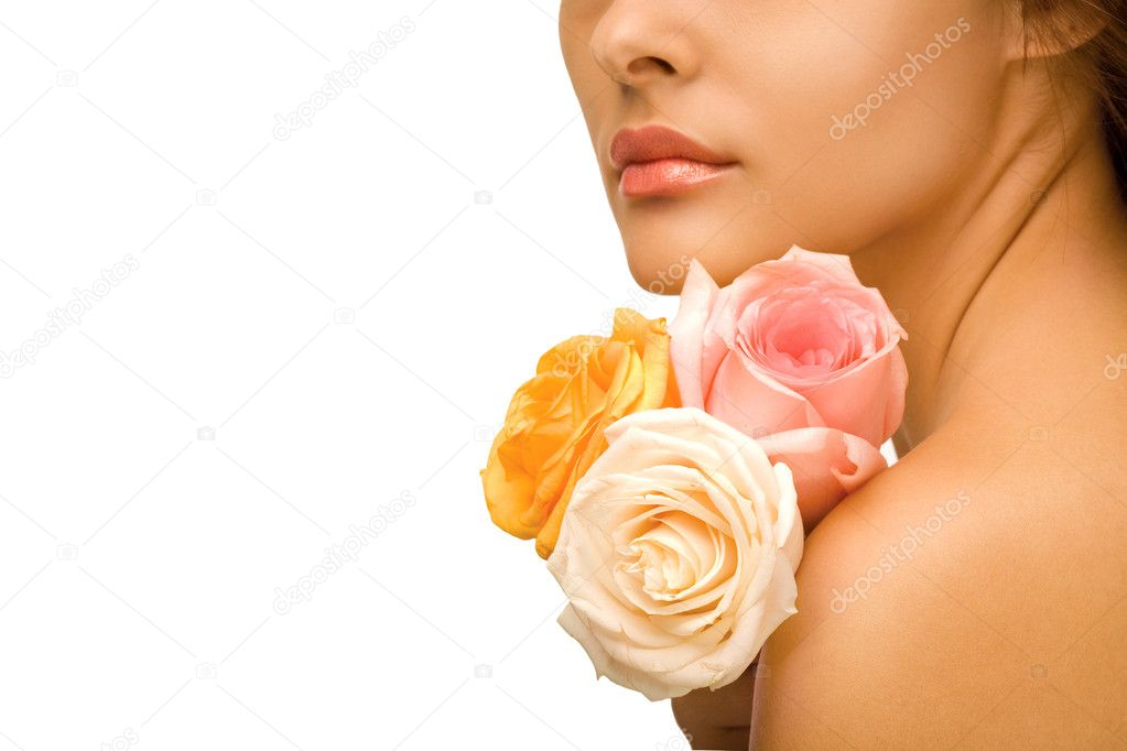 Close up of face and shoulder of beautiful woman with three colorful flowers nestled on neck, isolated on white background — Stock Photo #3079386