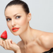 Young woman with strawberry. — Stock Photo
