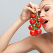 Woman with tomatoes. - Stock Photo