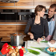 Cute couple in the kitchen — Stock fotografie