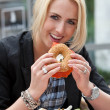 Eating a bagel — Stock Photo