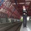 Pretty blond businesswoman waiting for the train — Stock Photo #2948612