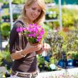 Pretty blond woman in gardening center — Stock Photo #2948660