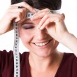 Pretty woman measuring her forehead — Stock Photo #2949670