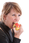 Biting in an apple — Stock Photo