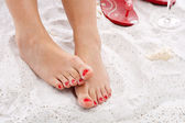 Feet in the sand — Stock Photo