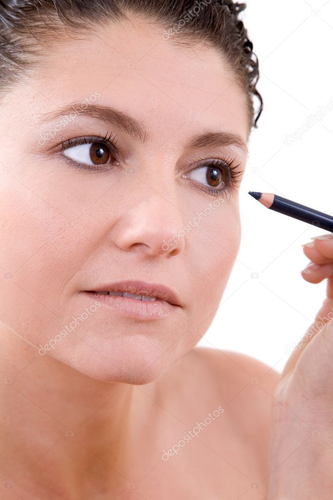 Beautiful brunette working on her makeup on white background — Stock Photo #2949437