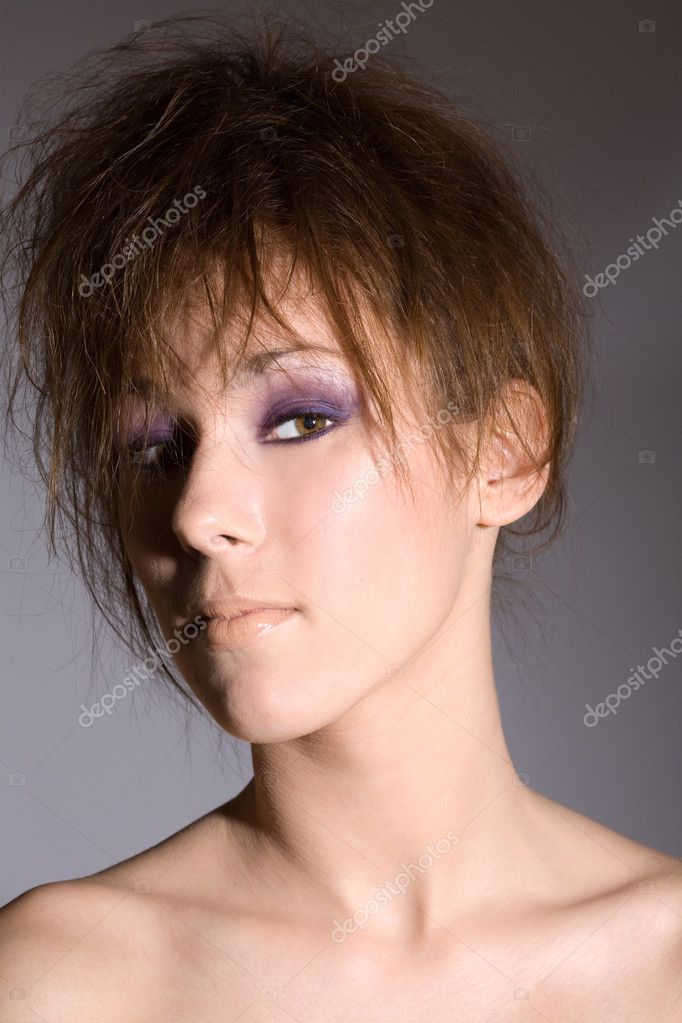 Beautiful brunette with messed up hairstyle on grey background  Stock Photo #2949912