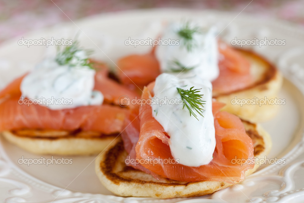Small pancake with salmon and sourcream and dille — Stock Photo #2960135