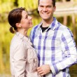 Lovely young couple outdoors — Stock fotografie