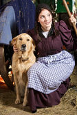 Farming girl and her dog — Stock Photo