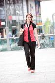 Beautiful young woman walking — Stock Photo