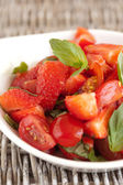 Tomato strawberry salad — Stock Photo