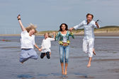 Jumping family — Stock Photo