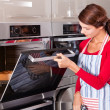 Stock Photo: Checking oven