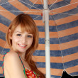 Cute girl under parasol — Stock Photo