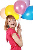 Girl holding air balloon — Stock Photo