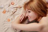 Girl on beach carpet — Stock Photo