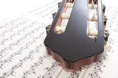 Closeup Guitar Headstock and Notes — Stock Photo