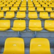 Stock Photo: Yellow seat in arena