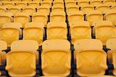 Infront из желтого сиденья на стадионе — Стоковое фото