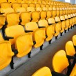 Yellow seat in footbal stadium — Stock Photo