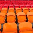 Orange and red seat in stadium — Stock Photo