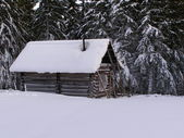 Hut in mountains in the winter — Stock Photo
