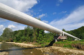 Pipeline transition through mountain small river. — Foto Stock