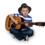 Kid playing guitar — Stock Photo
