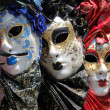 Row of venetian masks — Stock Photo