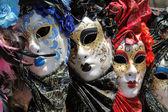 Row of venetian masks — Stock Photo