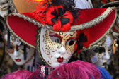 Venetian masks in gold and red — Stock Photo