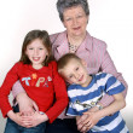 Grandmother with grandchildren — Stock Photo