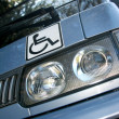 Stock Photo: Disability sign on car