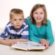 Girl and boy reading book. — Stock Photo