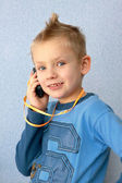 Young boy speaks by mobile phone — Stock Photo