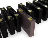 Brown case in row of black — Stock Photo