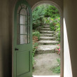 Stock Photo: Arched Doorway to Quiet Garden