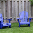 Stock Photo: Blue Adirondack Chairs