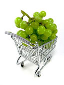 Green grapes in shopping cart — Stock Photo