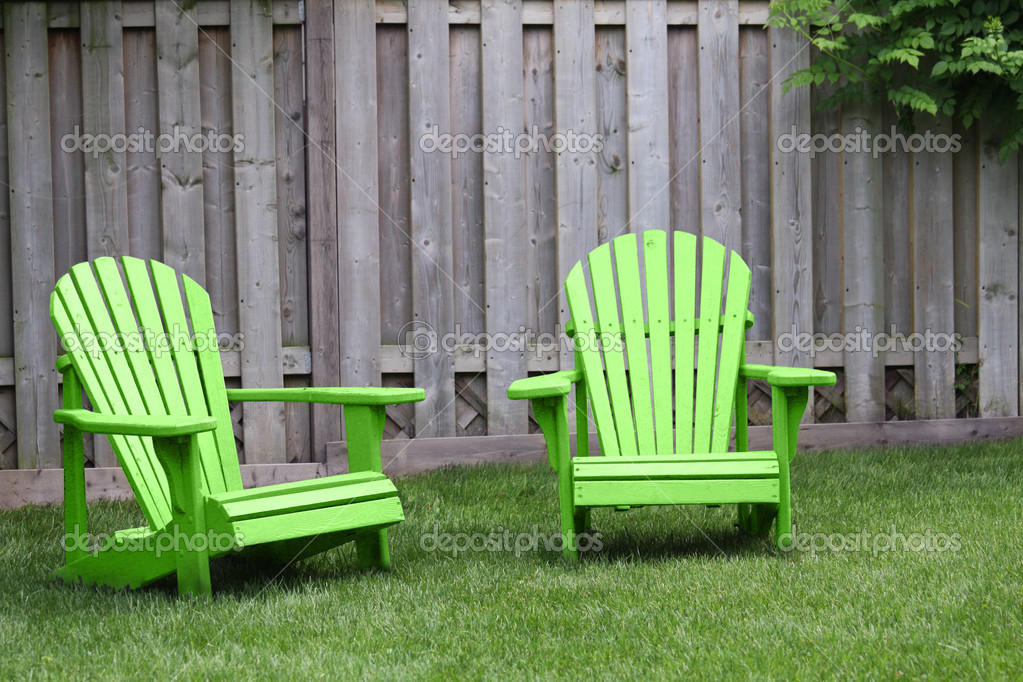 Two green adirondack chairs on green grass — Stock Photo #2972696