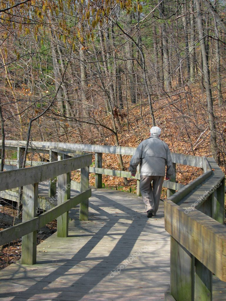 Senior citizen walking on boardwalk  Stock Photo #2973407