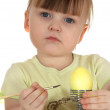 Girl with egg - Stock Photo
